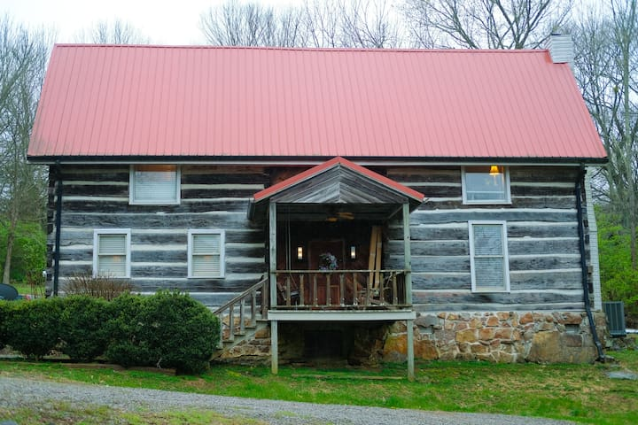 """Log Home in Franklin, Tennessee called """"The Rise and Shine Inn""""."""