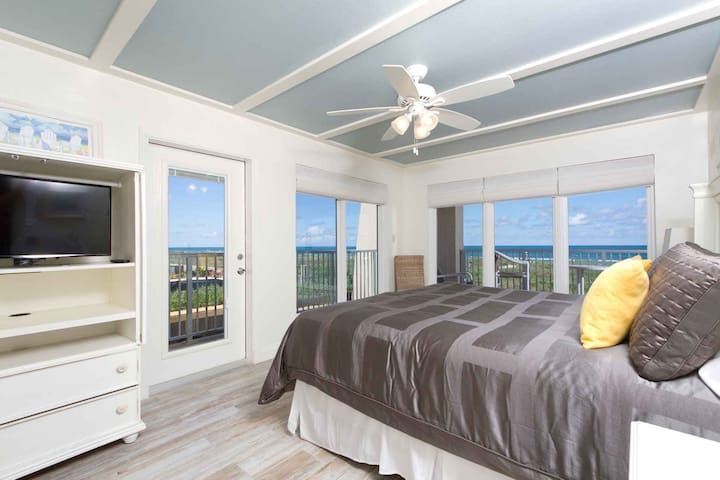 The corner bedroom has a separate balcony access.