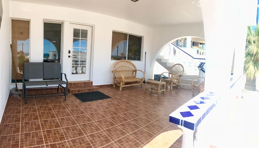 Covered patio with plenty of seating to enjoy the ocean views
