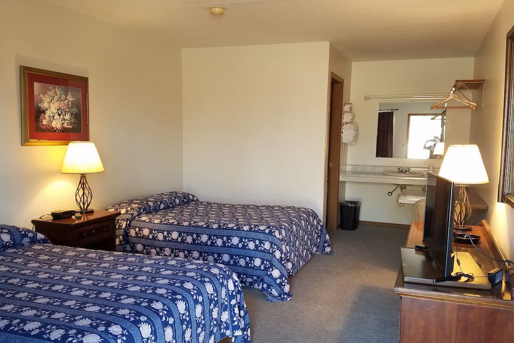 Room 2 with two full-size beds, private entrance, bath, and TV