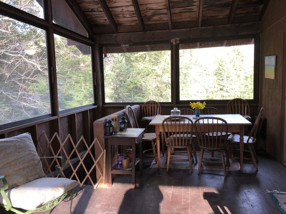 Large screened in porch with dining table