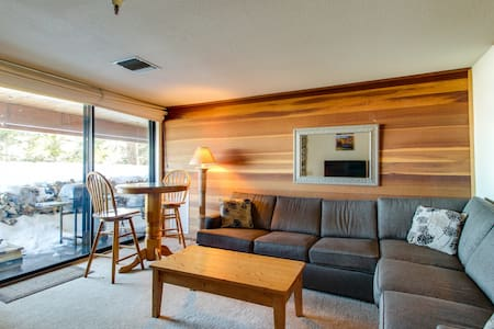 Ski-in / ski-out condo featuring private hot tub as well as a deck with grill