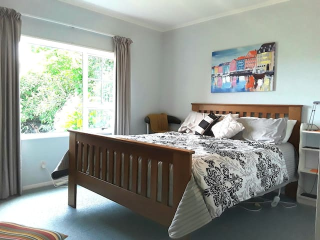Spacious comfortable queen bed in your room. Bottom storey of the house so very quiet!