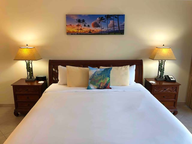 The king size bed comes with four comfortable pillows, and a decorative Hawaiian pillow.