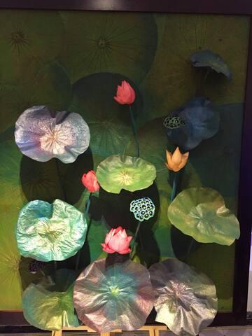 lotus paintings on display at the hue lotus homestay