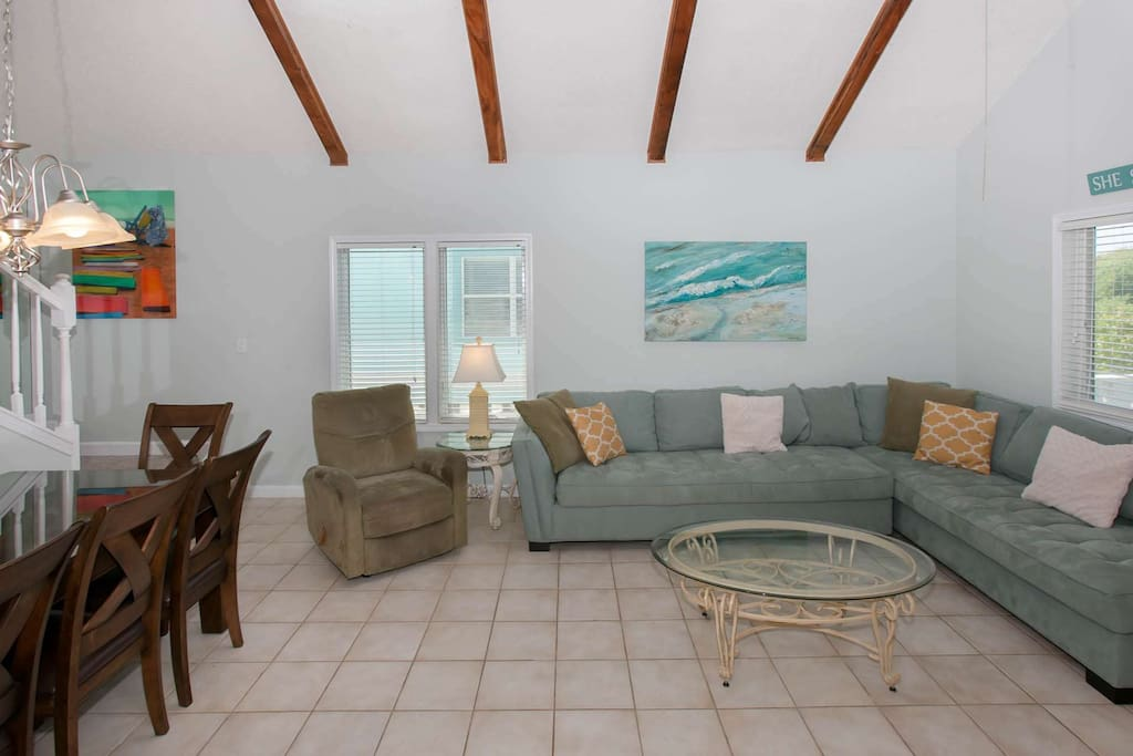 First floor tiled living room with ceiling beams
