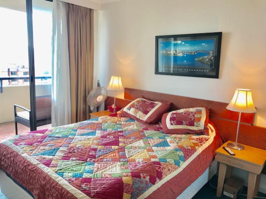 The Guest Bedroom features a Queen-Size Bed, 2 Bedside Tables and access to a large Private Balcony