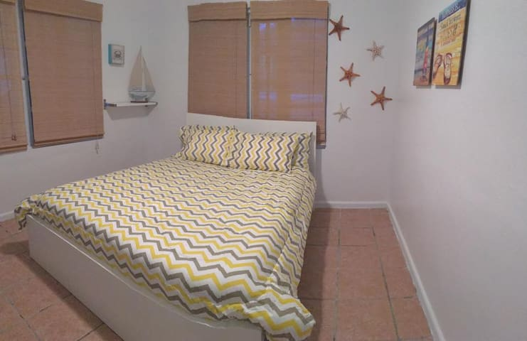 Comfortable queen bed with AC and an ample closet