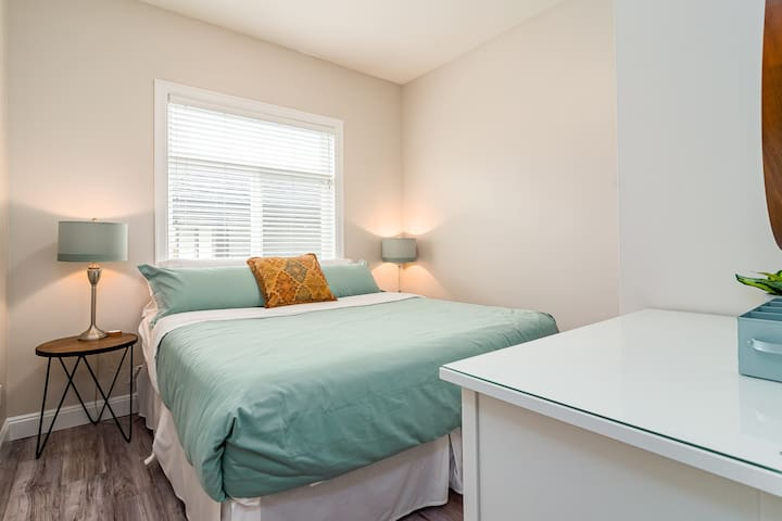 King Bed! 2 nightstands with plug in charger pads. Bright western exposure extra large window. 3 drawer Dresser.