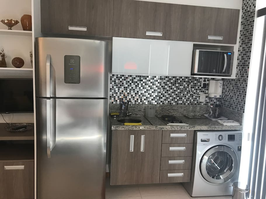 Brand new, stainless steel appliances in well equipped kitchen
