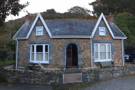 Room in a traditional Guernsey cottage by the sea.