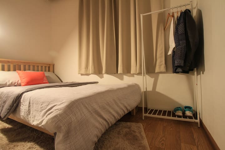There is a clothes rack next to the bed as well.