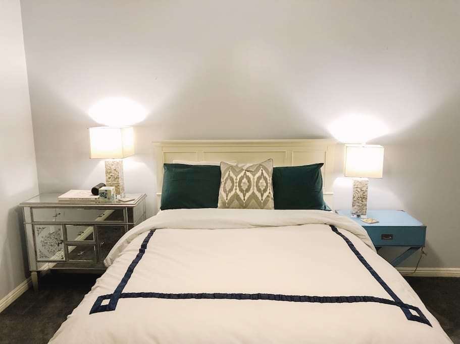 Queen bed in bedroom (from Tufts and Needles).