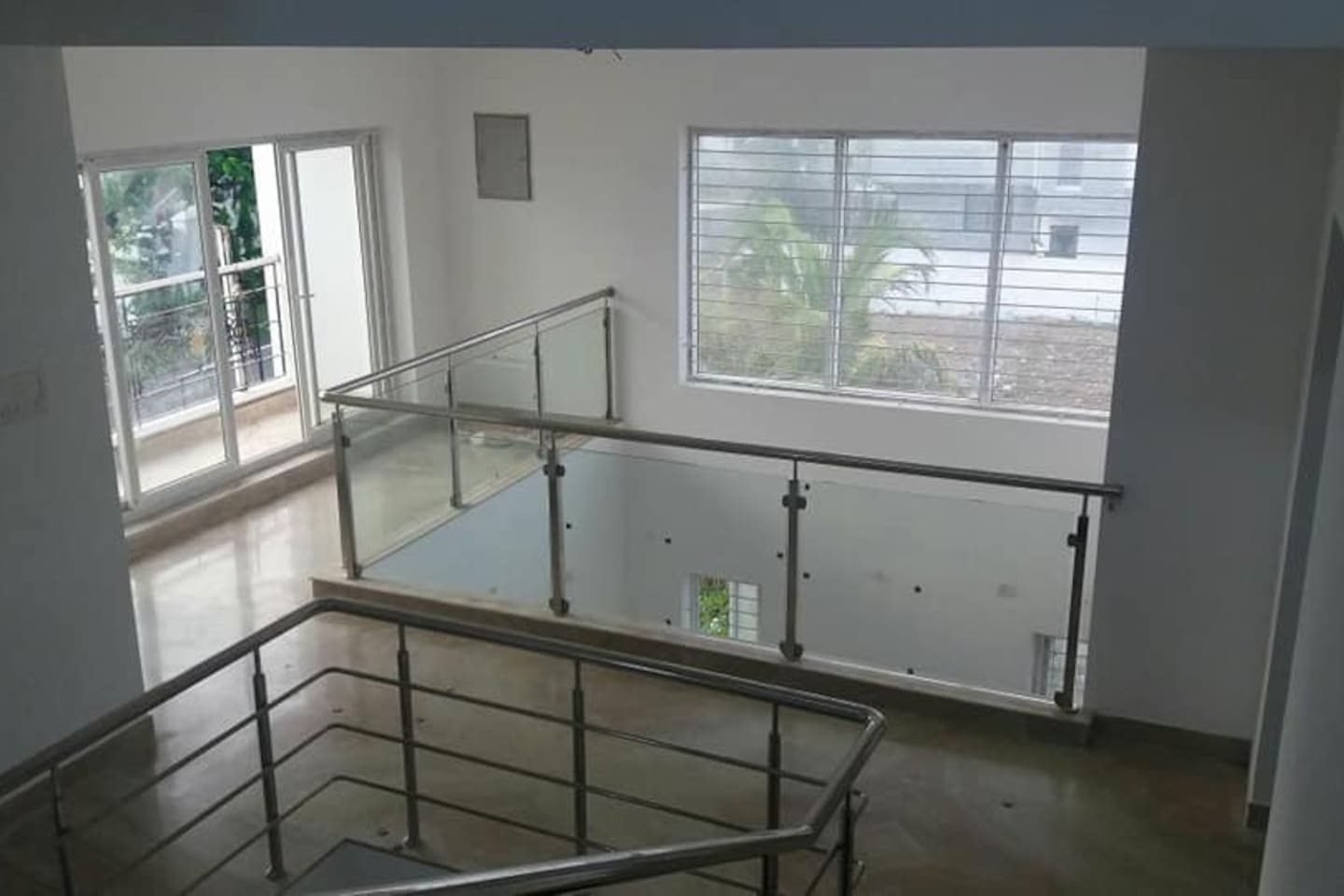 View from stairs between roof top and the first floor access