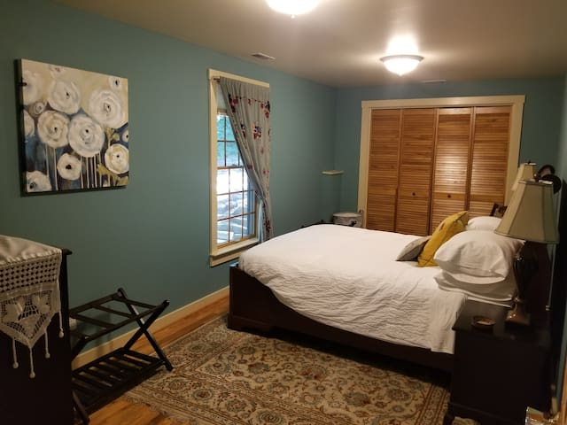 The Siena bedroom with a Queen bed and luxury linens