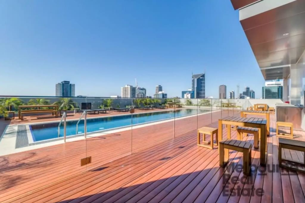Lounging area at rooftop pool of my apartment. Photo credit: Melbourne Real Estate