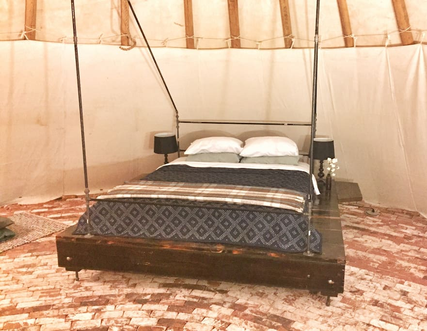 king sized bed in the large tipi