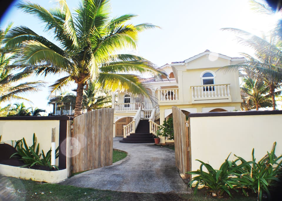 Street view of the Villa. Secure and easy gated access with circular driveway.