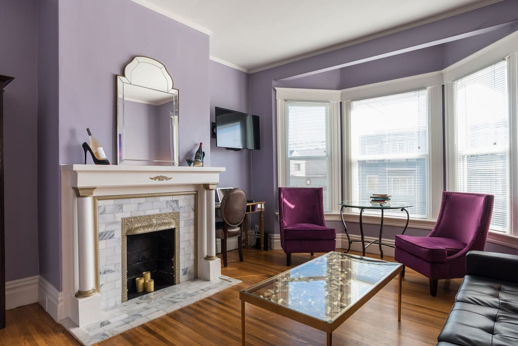 My Living room is a tribute to Prince with Purple Walls and Chairs.