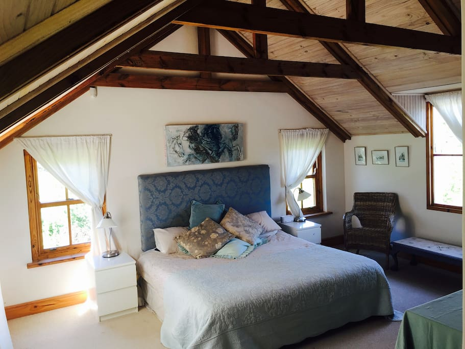 Very spacious main bedroom with king size bed.