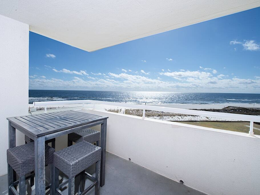 A 4-person high-top table lets you dine al fresco with the Gulf of Mexico as your backdrop.