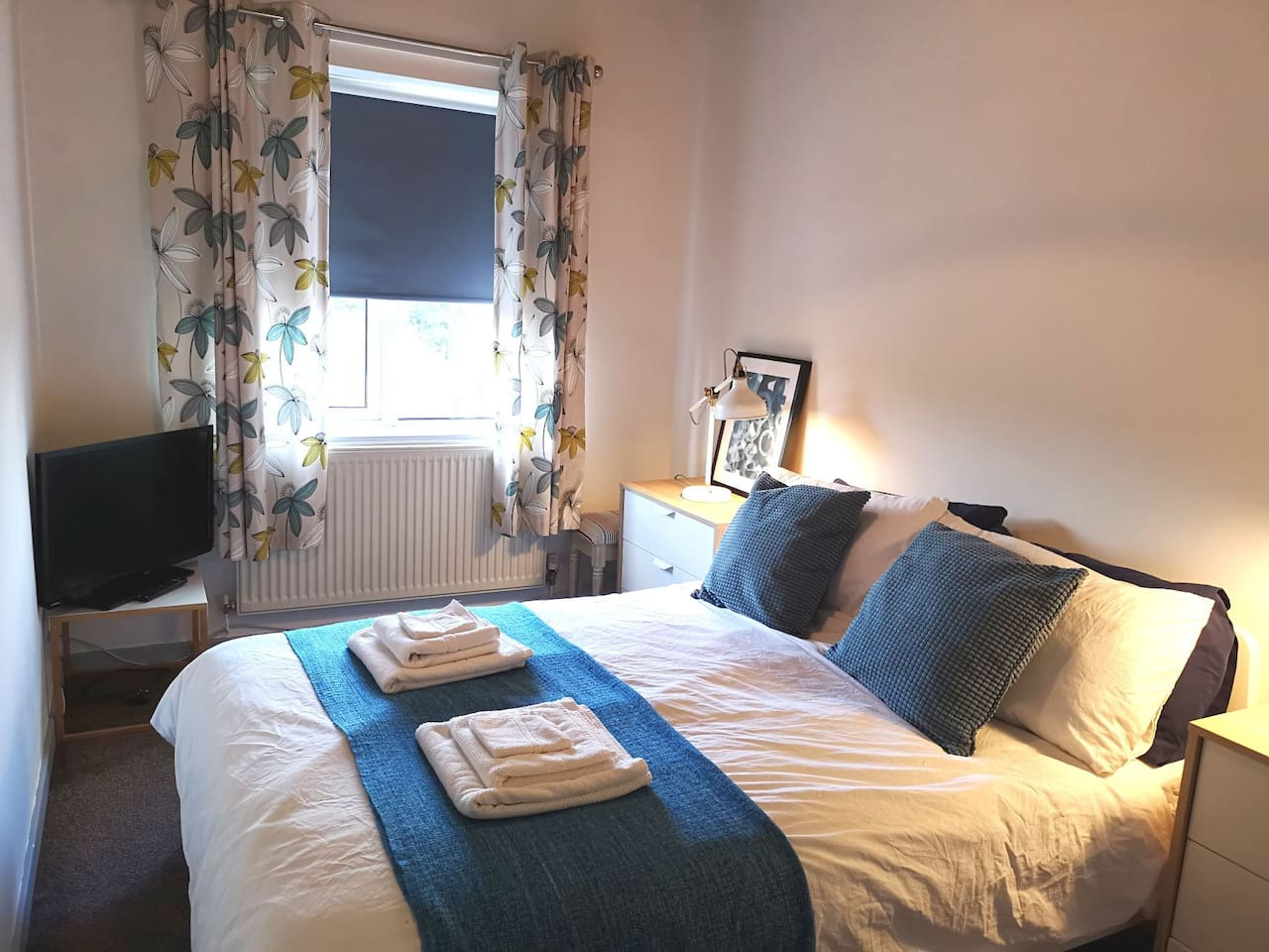 Comfortable double bed, towels, TV, plenty of pillows.