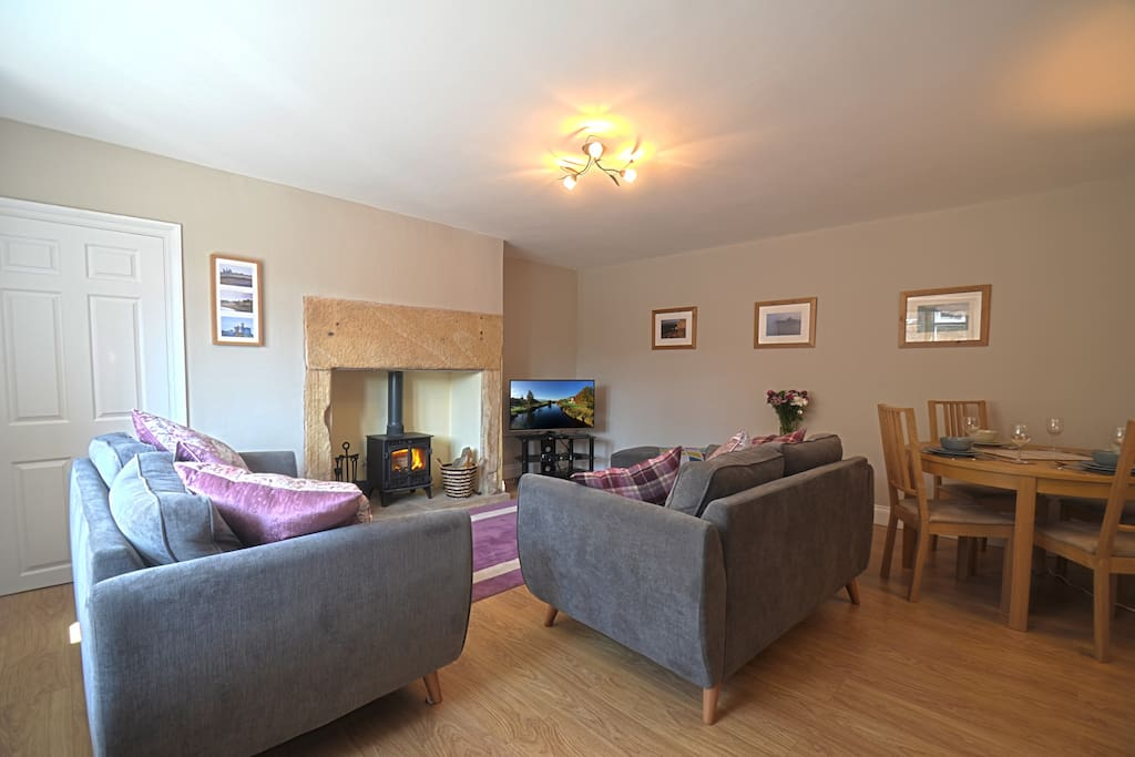 The spacious Living Room offers a stove, comfy sofas and a Dining Table for four people.