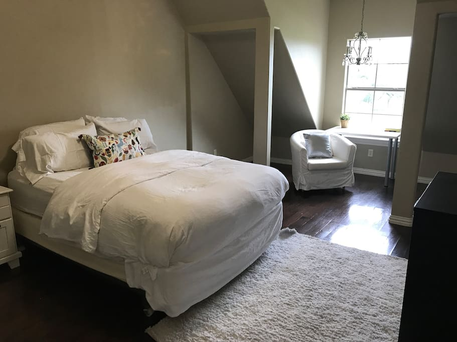 This large bedroom has a bathroom located inside the room.