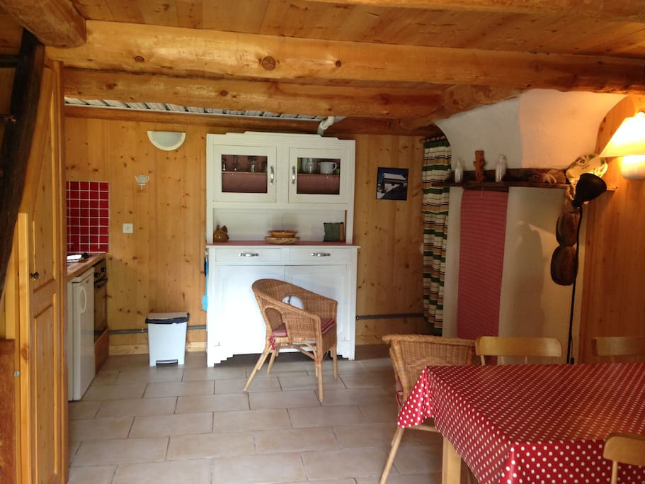 The main room from the entrance (kitchen corner on your left, fire place and table on the right)