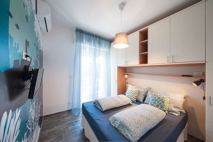 double bedroom with tv