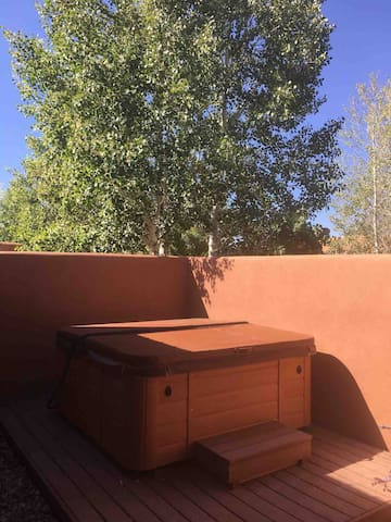 Private courtyard with private hot tub, accessible by both bedrooms. Outdoor furniture, clothesline for towels and rug included.