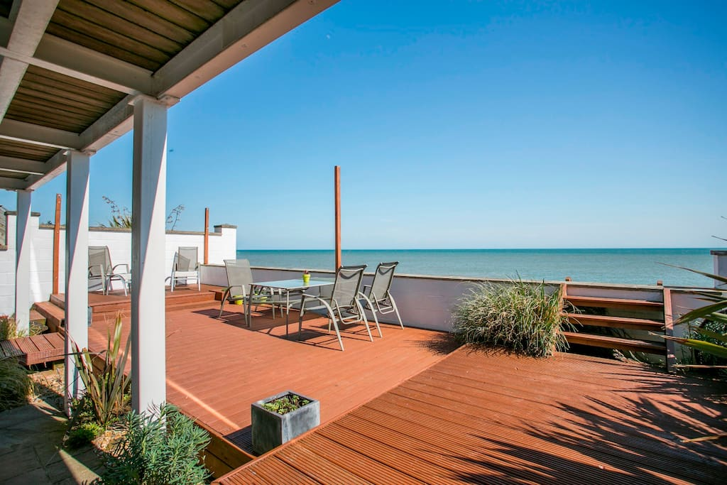 Large decked area overlooking the private beach