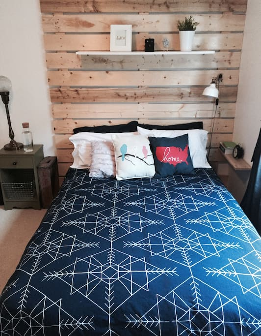 bright, super cozy room with amazing comfy bed. ample closet space, dresser, ironing board + black out blinds. great if you choose to sleep in.
