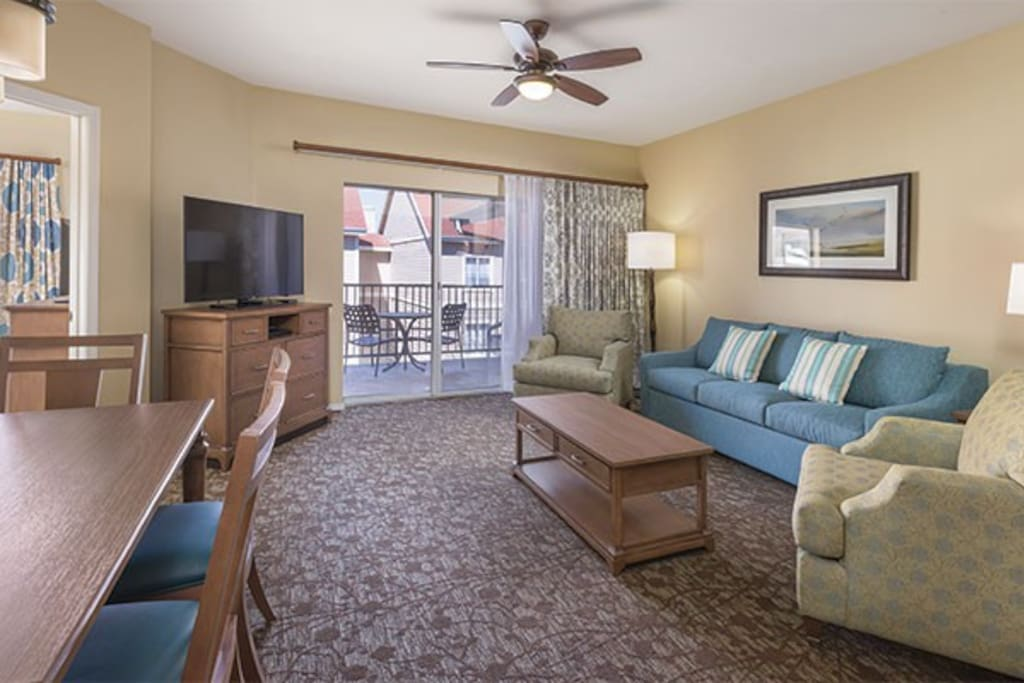 Decor is the same, but the Suite Living Area is smaller, has a round table for 4, and lacks balcony.  See Floor Plan.