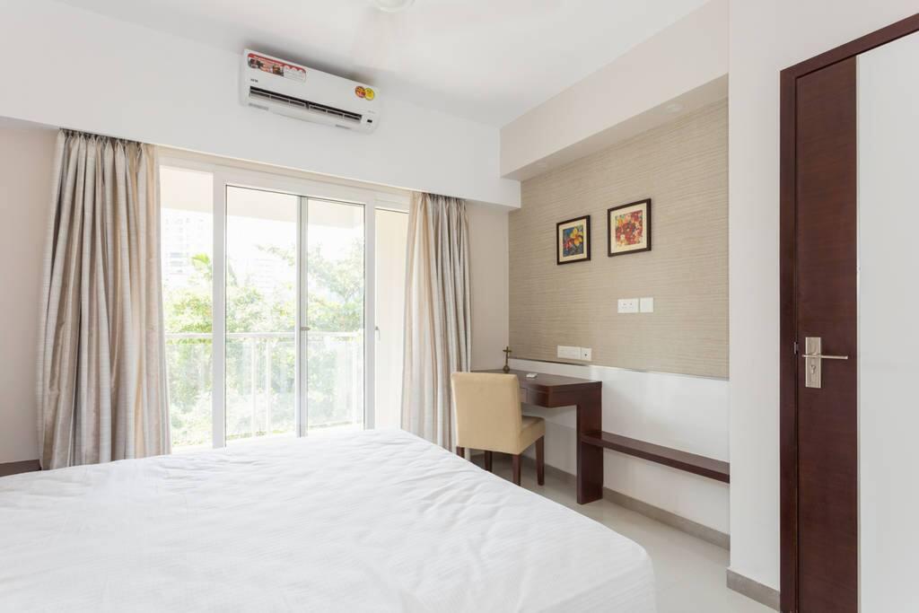 Bedroom with work table,balcony