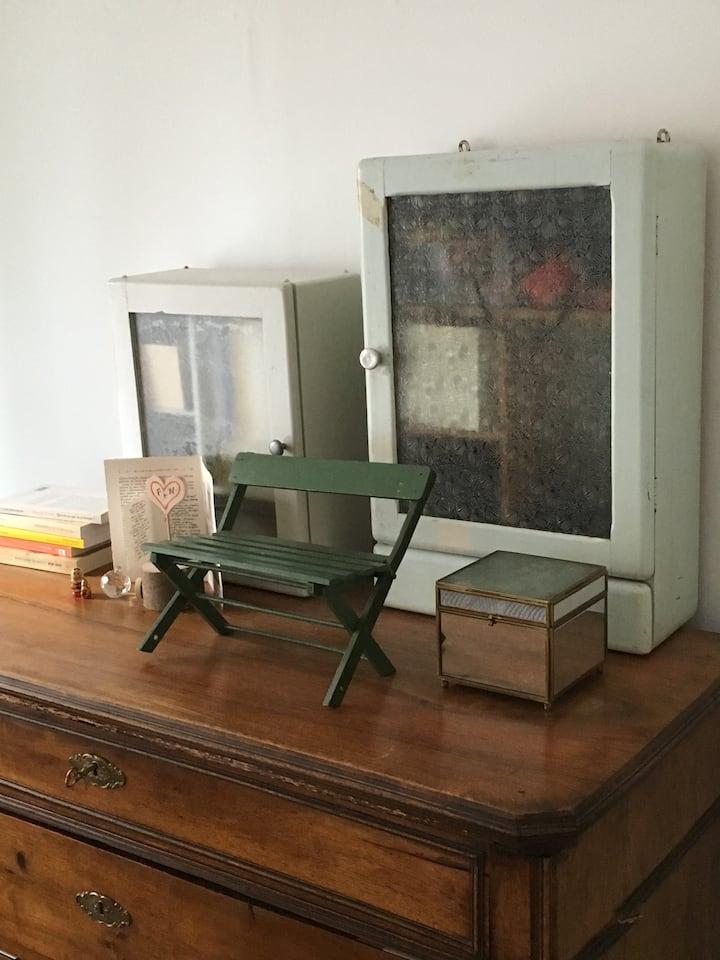 Chambre privée dans une ancienne boutique