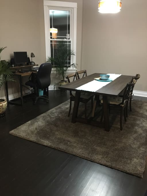 Dining area with desk and computer with wifi