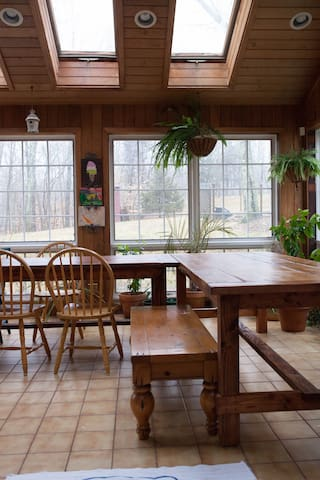 Sun Room (off the family room) for big crowd eating or board games.  Filled with tons of natural light and view of the forest.