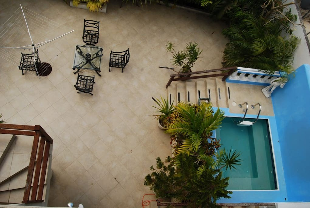 Outside seating area by the plunge pool and hammock.