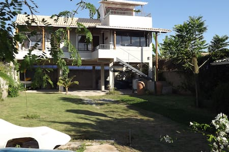 House 200m from the beach, 8 km from the village and 95km from the Rio de Janeiro. With 2 bedrooms, 1 bathroom, 1 lavatory, living room, kitchen, terrace and large garden.