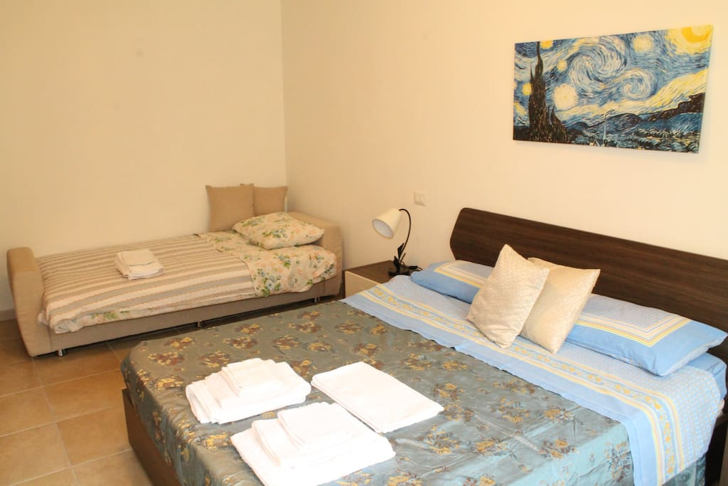 Double bed and the single sofa bed (opened) in the triple bedroom.