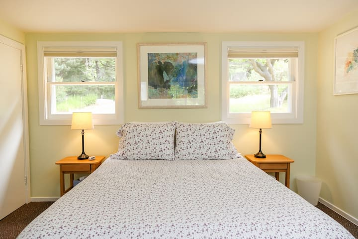A luxuriously comfortable new, queen size Deluxe FloBed with yummy bedding.