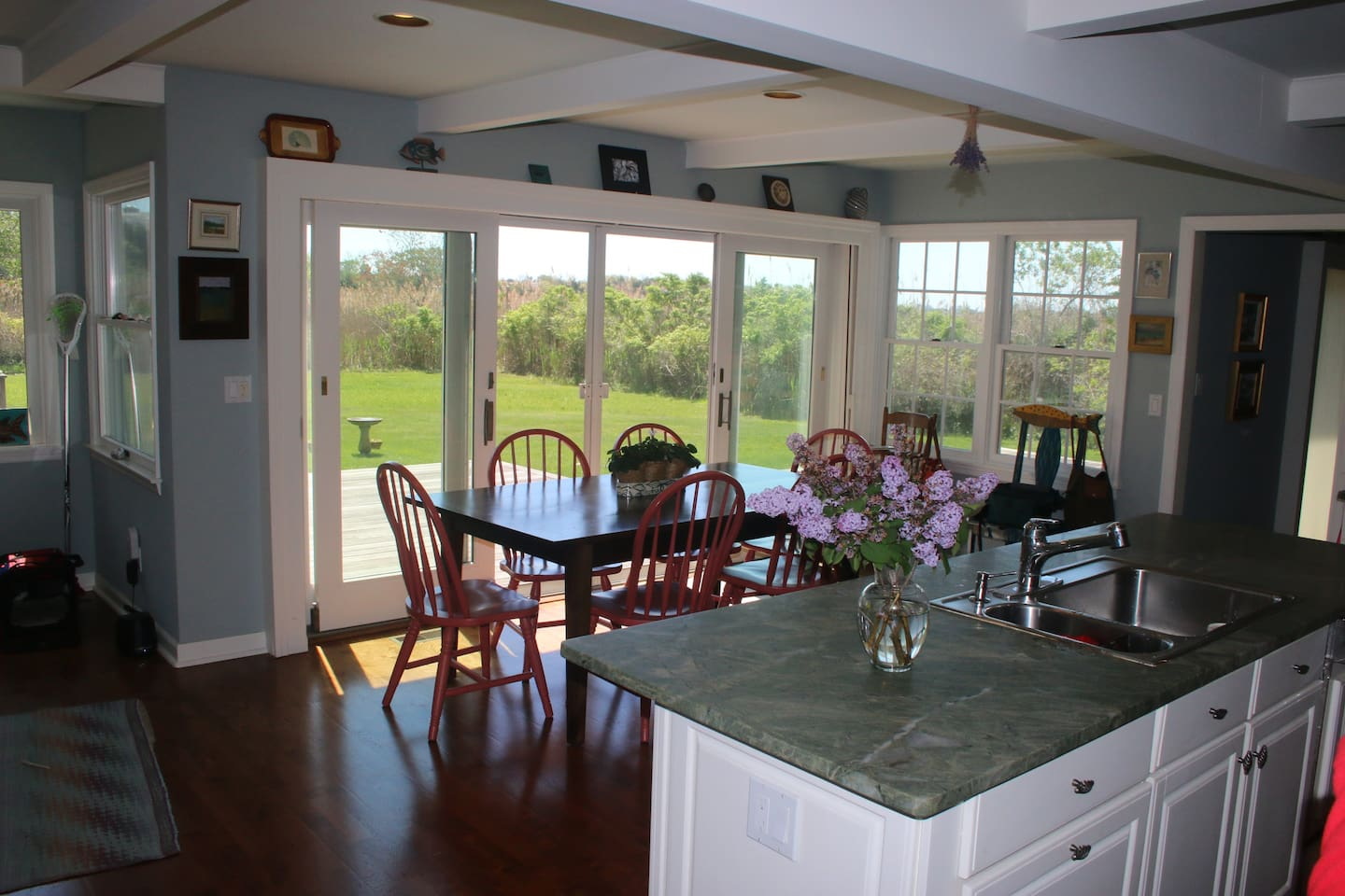 Large eat-in kitchen opens to spacious deck.