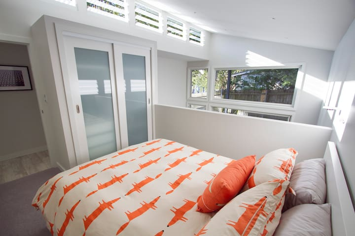 Light filled bedroom with loads of storage space.