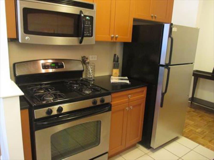 Fully equipped kitchen with full size appliances, pots, pans, and dishes