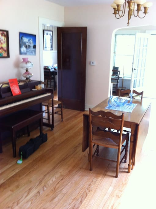 Dining room with piano for guests to play (gently).