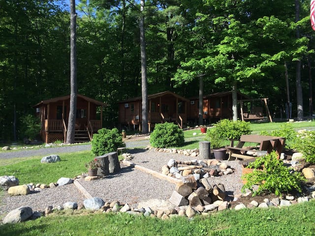 When not by the lake, enjoy day and evening fun around the upper camp fire area.