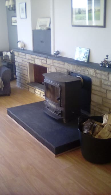 Large living room with woodburner