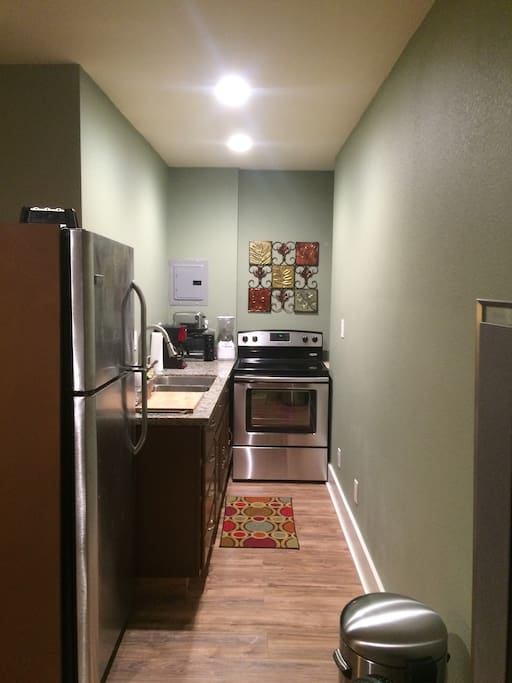 Full kitchen, including a range, full refrigerator, toaster, microwave and more!