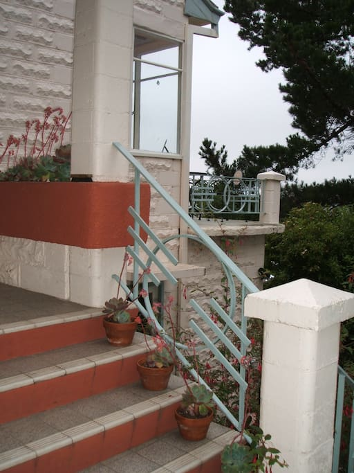 Front steps with view to balcony.
